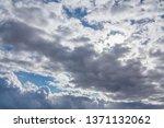 sun shines through the overcast ... | Shutterstock . vector #1371132062