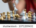 hand of woman playing chess for ...   Shutterstock . vector #1371209432