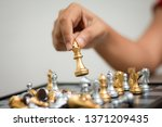 hand of woman playing chess for ...   Shutterstock . vector #1371209435