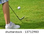 golf chip shot with ball leaving club after impact - stock photo