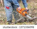 worker using chain saw and... | Shutterstock . vector #1371336098