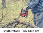 worker using chain saw and... | Shutterstock . vector #1371336125