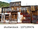 A Boarded Up General Store Is...