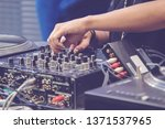 female hand playing dj mixer | Shutterstock . vector #1371537965