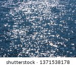 glare on the surface of blue... | Shutterstock . vector #1371538178