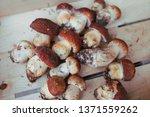 natural raw mushrooms top view...   Shutterstock . vector #1371559262