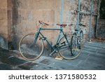 cityscape  bicycle parked in... | Shutterstock . vector #1371580532