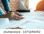 hand of young engineering man... | Shutterstock . vector #1371696452