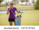 cute hispanic golfer choosing... | Shutterstock . vector #137174762