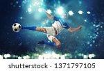 soccer striker hits the ball... | Shutterstock . vector #1371797105