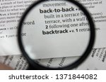 Small photo of The word or phrase backtrack in a dictionary.