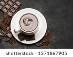 cup of hot chocolate and pieces ...   Shutterstock . vector #1371867905