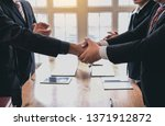 business people shaking hands.... | Shutterstock . vector #1371912872