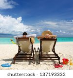 couple on a tropical beach at... | Shutterstock . vector #137193332