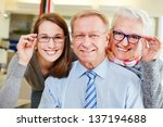 happy family buying new glasses ... | Shutterstock . vector #137194688