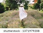 stylish hipster girl in linen... | Shutterstock . vector #1371979208