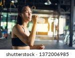 sporty beautiful woman... | Shutterstock . vector #1372006985