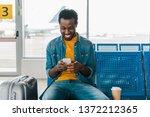 smiling african american man... | Shutterstock . vector #1372212365