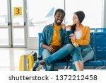 happy african american couple... | Shutterstock . vector #1372212458