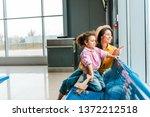 happy african american mother... | Shutterstock . vector #1372212518