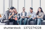 Stock photo creative designer take coffee break at office cafeteria multiethnics employee sitting at sofa and 1372274228