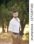 beautiful young man    Shutterstock . vector #1372287182