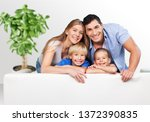 beautiful smiling family on... | Shutterstock . vector #1372390835