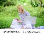 woman with laptop sit on rug... | Shutterstock . vector #1372399628