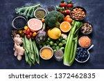 healthy organic food on dark... | Shutterstock . vector #1372462835