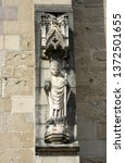 Small photo of Sculpture of Saint Jerome, monumental standing figure on the outer side of the flying buttress pier at medieval Gothic Black Church in Brasov city. Transylvania, Romania