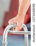 Small photo of Closeup image of man using a walker to assist with rehabilitation