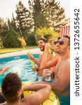 group of friends at a poolside...   Shutterstock . vector #1372655642