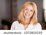 middle aged woman smiling at... | Shutterstock . vector #1372825235