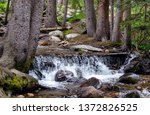colorado waterfall in a beautiful wooded area near Mount Evans - stock photo