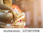 Close Up Buddha Statue With Ra...