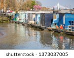 a row of houseboats moored on... | Shutterstock . vector #1373037005
