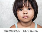 young girl in the philippines... | Shutterstock . vector #137316326