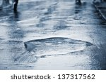 puddle of water in rain | Shutterstock . vector #137317562
