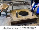 Small photo of The worker is preparing a sand mold. Molds made of sand are relatively cheap, and sufficiently refractory even for steel foundry use.