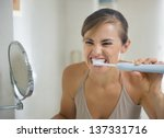 Young Woman Brushing Teeth Wit...