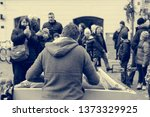 street musician performing... | Shutterstock . vector #1373329925