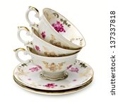 Antique Tea Cups Stack On Whit...