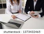 men's and women's hands... | Shutterstock . vector #1373432465