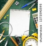 school supplies on blue... | Shutterstock .eps vector #1373590595