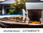 wooden table in heavy rain | Shutterstock . vector #1374085475