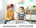 female teacher with child at...   Shutterstock . vector #1374123548