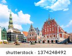Small photo of View of the Old Town Ratslaukums square, Roland Statue, The Blackheads House near St Peters Cathedral against blue sky in Riga, Latvia. Summer sunny day