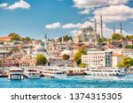 Small photo of Touristic sightseeing ships in Golden Horn bay of Istanbul and view on Suleymaniye mosque with Sultanahmet district against blue sky and clouds. Istanbul, Turkey during sunny summer day.