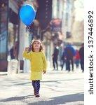 Little Girl Walking Down The...