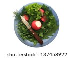 greens and radishes on a blue... | Shutterstock . vector #137458922